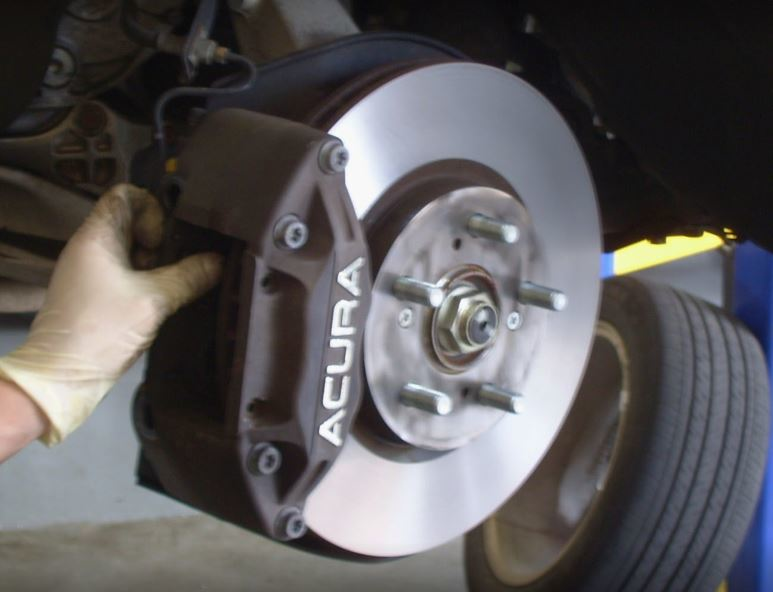 auto technician working on brakes in Los Angeles