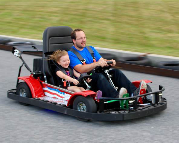 Adult in child are riding a go kart in Leesport, PA.