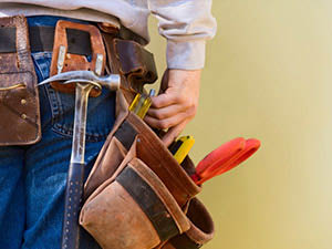 Man with a handyman belt full of tools
