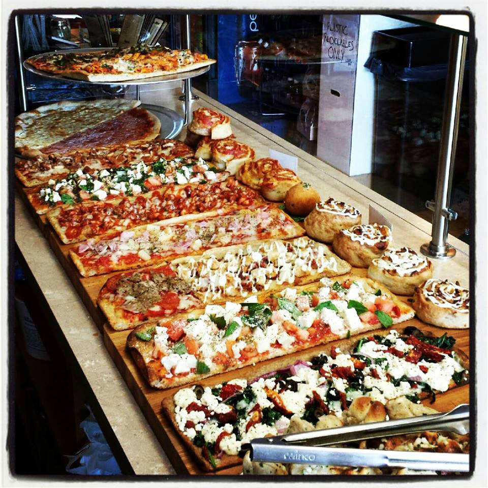 A wide assortment of fresh Pizza Mia specialty pizzas