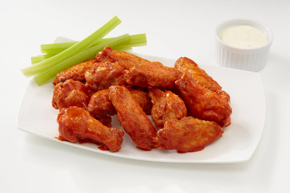 Chicken wings served with celery