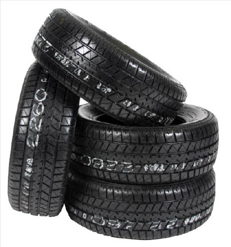 Stack of 4 new tires.