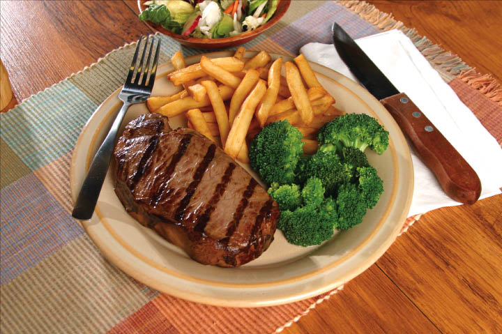 New York Strip steak, broccoli and fries entree.