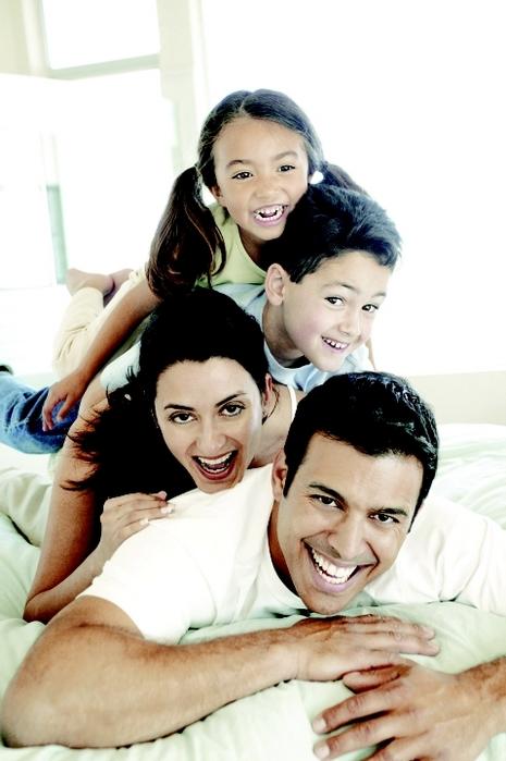 ABC Family Dental & Orthodontics in Aurora, CO family man woman boy girl smiling
