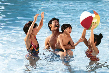 inground pool with happy family