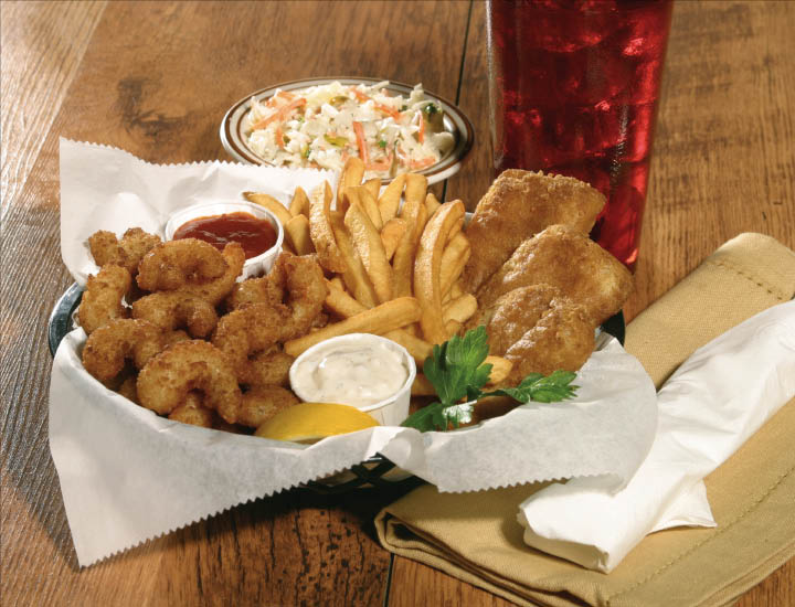 Fried fish, fried shrimp, French fries and cole slaw meal