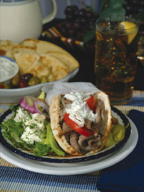 Gyro lamb sandwich with pita bread and salad