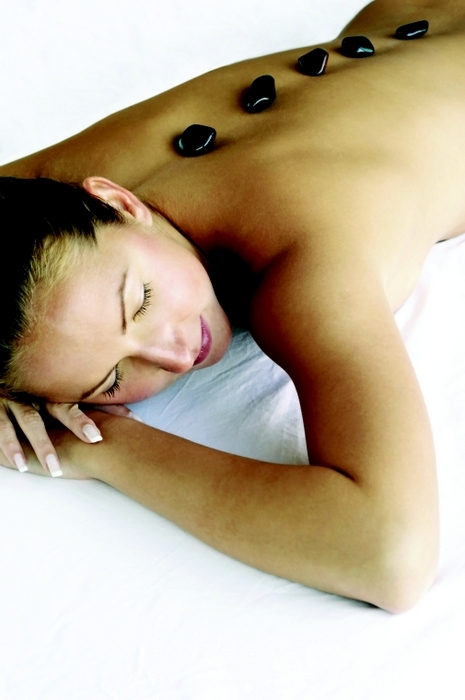 Hot stone massage from ESOE Massage in Elm Grove, WI