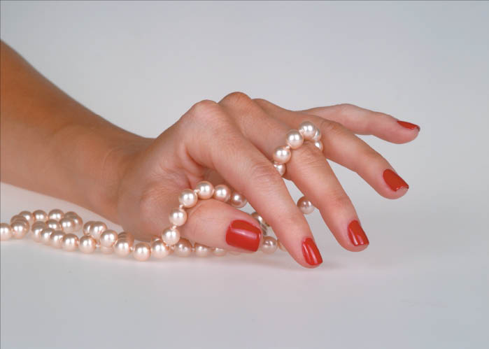 Pretty polished nails look great with pearls