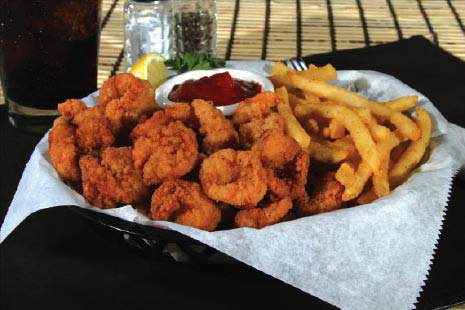 Nary's breaded shrimp dinner are served with tasty BBQ sauce and fries.