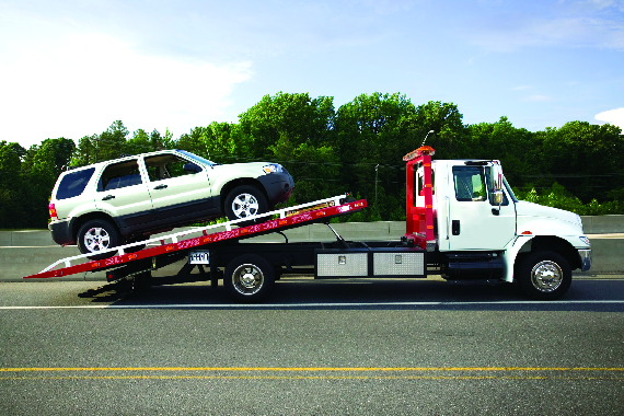 photo of car placed on tow truck at US Auto of Sterling Heights, MI