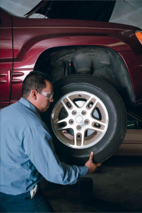Automotive technician wheel alignment in Arlington Heights, IL
