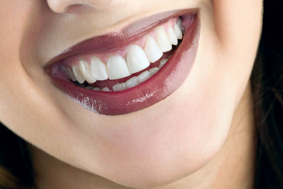 Full lip and lip liner frames your smile in color