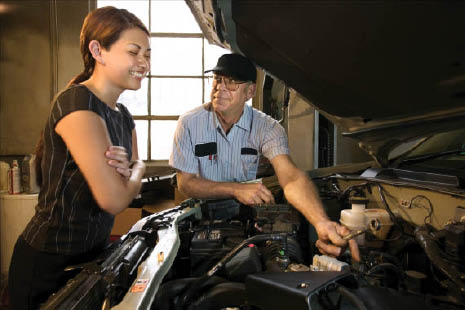 local mechanic and client discussing auto care needs