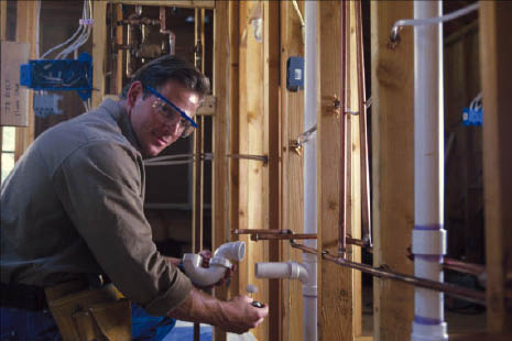 plumber installing new pipes in home under construction; Gaffney Plumbing