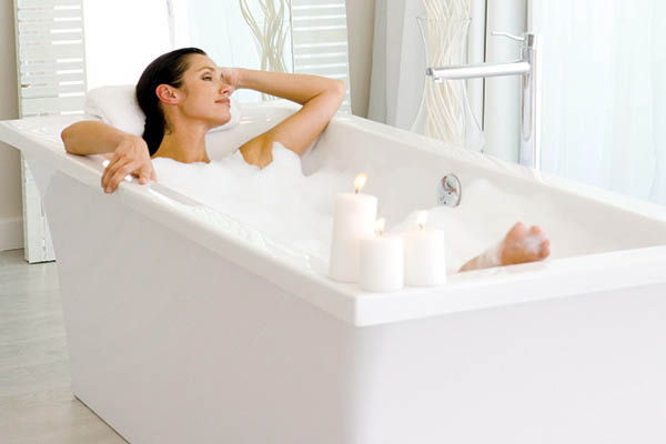 woman relaxing in new bath tub