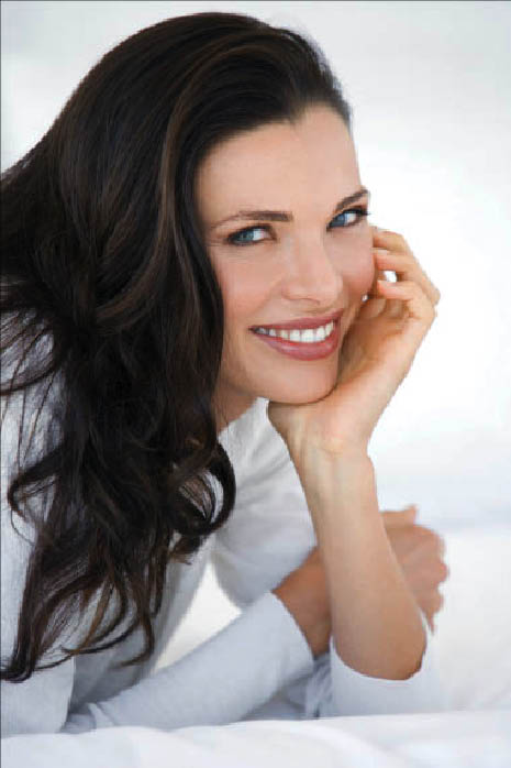 Brunette woman with white smile after teeth whitening at Gentle Dental Brentwood, CA