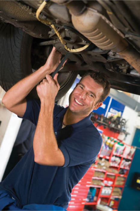 certified auto mechanic under vehicle on lift; auto repair; transmission repair at Monterey Auto Service near Milpitas, CA