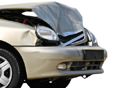 car with front end smashed in from auto accident; Master Paint and Auto Body Repair