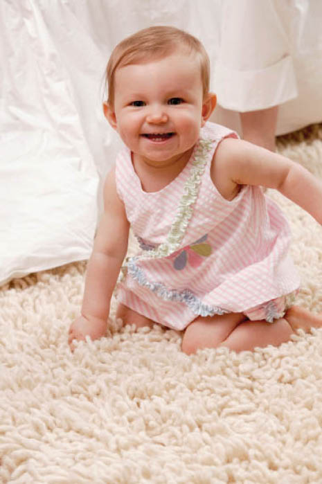 Baby girl on carpet cleaned by Steamco Cleaning and Restoration in San Diego County, CA