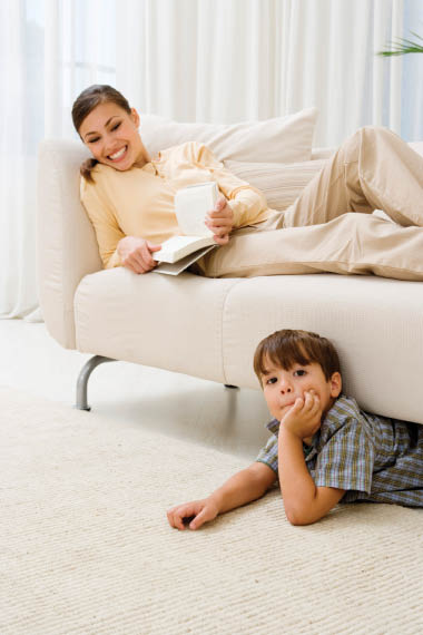 Mom on white couch; child white carpet; upholstery cleaning; carpet cleaning; Steamco Cleaning;  Carlsbad, CA