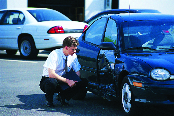 Service adjustor looking at an auto insurance claim through Morse Insurance Agency