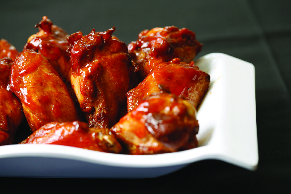 buffalo chicken wings on a white plate