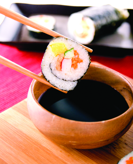 Freshly rolled sushi punctuated with soy sauce in Ankeny, IA