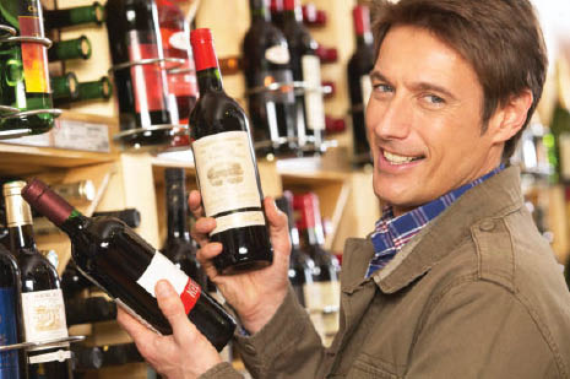 man buying wine