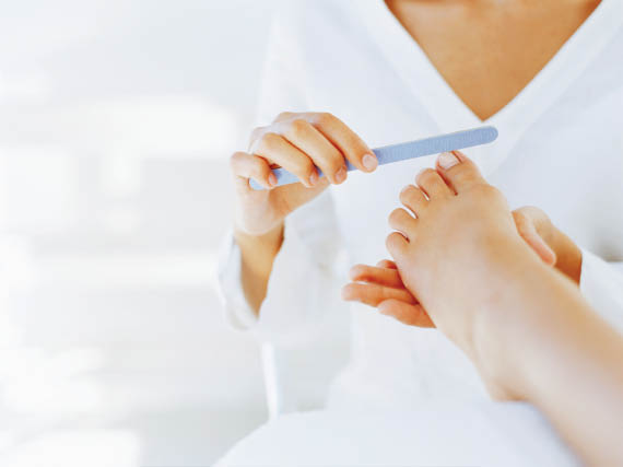 Our pedicure services include toe nail filing with a clean nail file