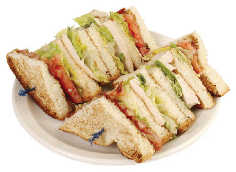 Turkey BLT sandwiches on a plate.