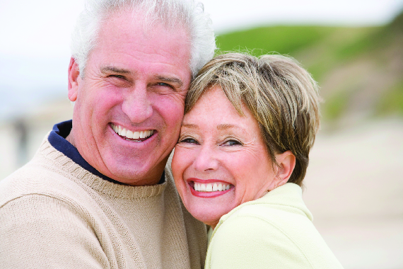 older male and female smiling; dentures; one-day dentures