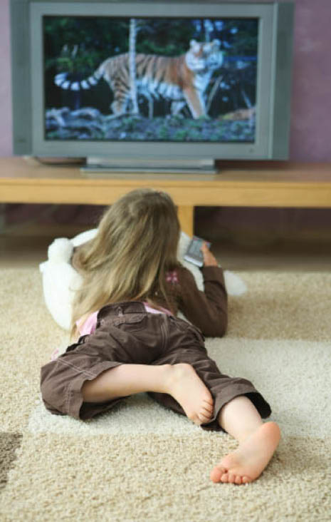 young girl watching tv on a freshly cleaned carpet