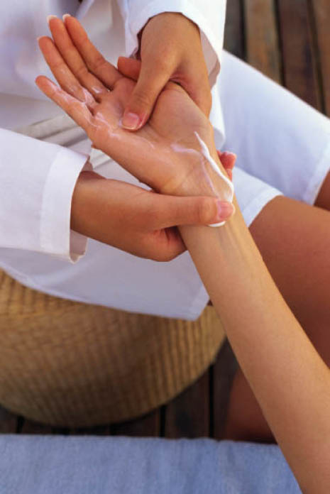Hand and arm massage during a manicure at Tip Toe Nails & Spa.