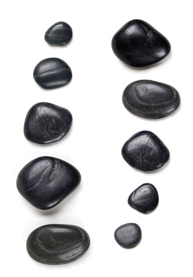 Hot stones used for massage at Tip Toe Nails * Spa.