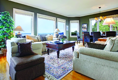 large windows installed in a waterfront facing living room