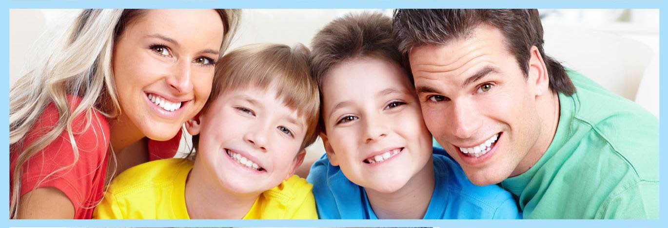 Family dentistry - Mom, Dad & kids smiling