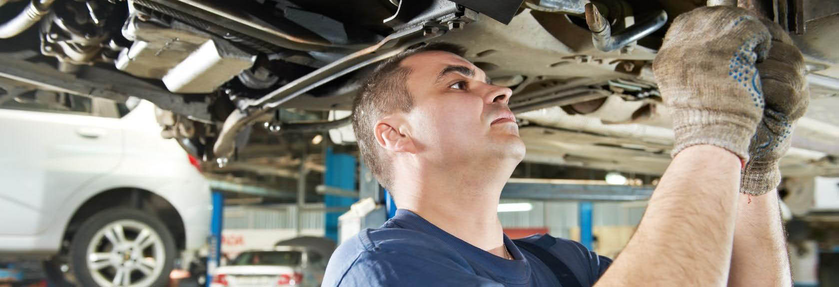 Schlee Bros. Automotive in San Rafael, CA - mechanic working on undercarriage of vehicle banner ad
