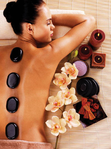 Full body assage with oil and hot stones.