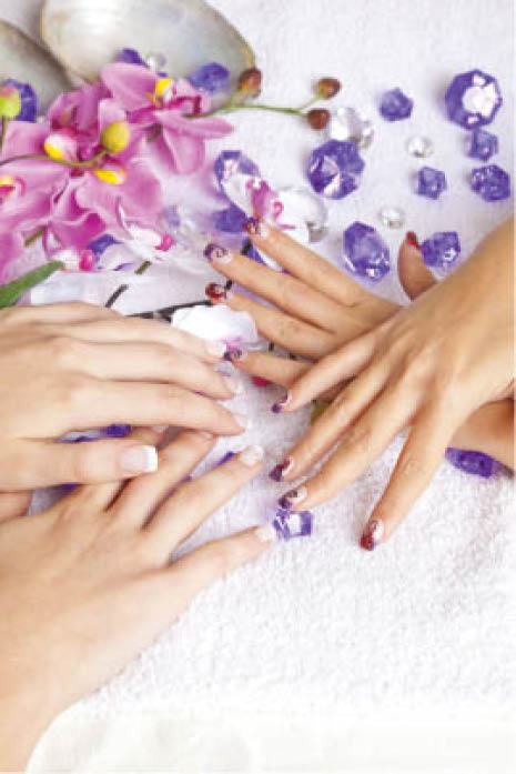 two women's hands with fresh manicures and polish by Pacific Nails and Spa in Omaha, NE