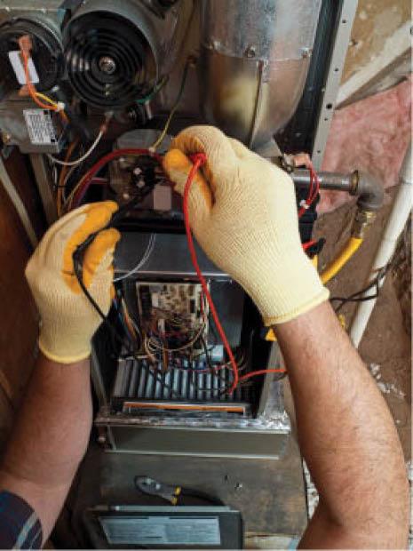 HVAC service technician working on AC repair in Pontiac, MI
