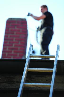 Handyman repairing chimney flashing