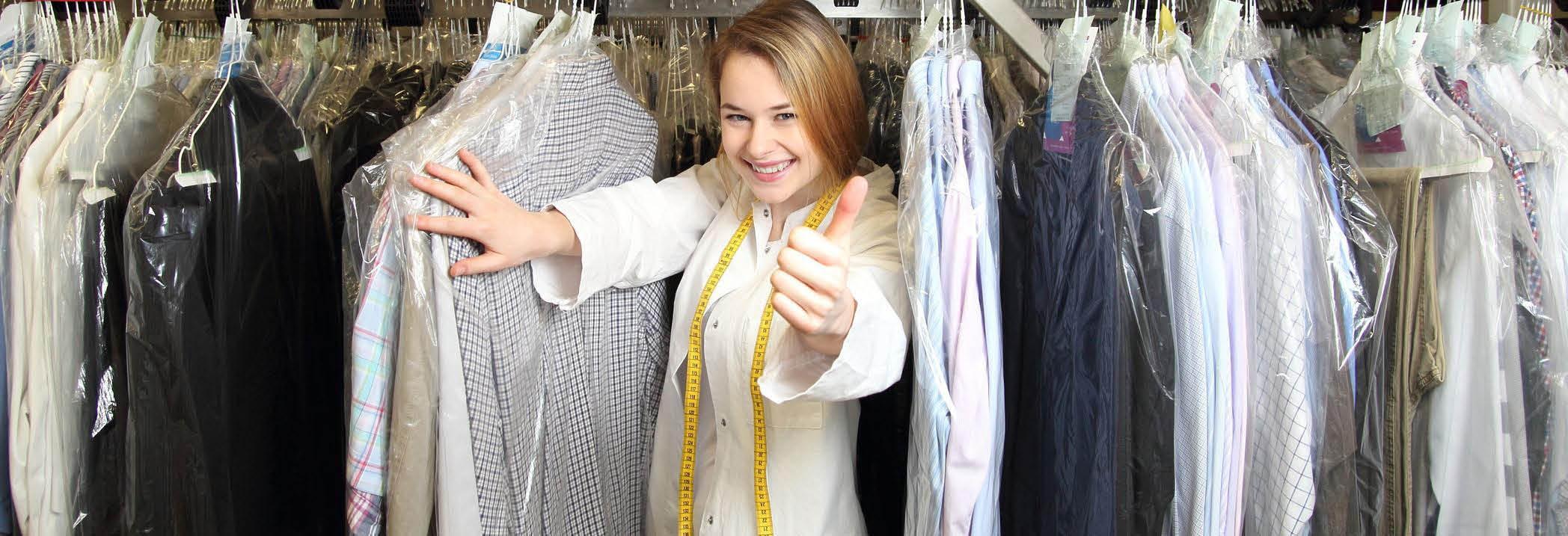 Woman in cleaned clothes with tape measure around her neck