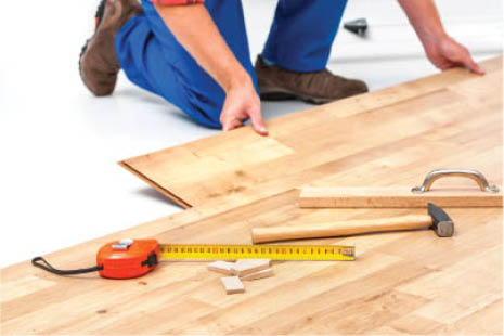 local handyman installing hardwood flooring
