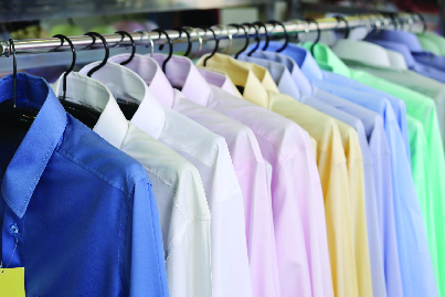 Starched dress shirts on hangers