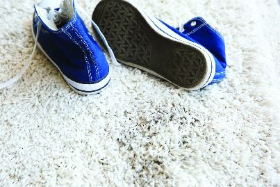 dirty shoes on white carpet
