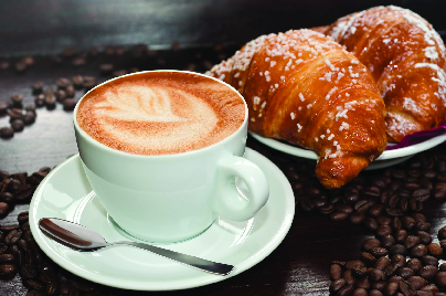 Freshly made latte and croissant