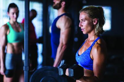 women & men working out
