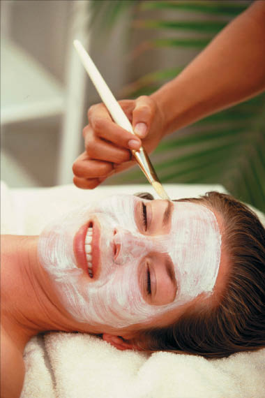 Florida College of Natural Health Pompano Ft. Lauderdale FL facial woman relaxing student facial mask client