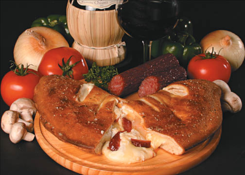 Calzone with melted cheese, dried meats, tomatoes and more